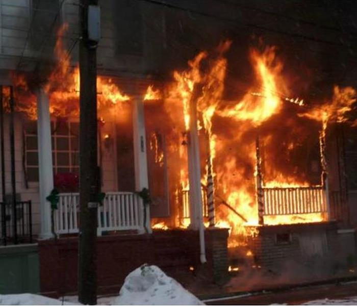 Fire coming out of the front of a house